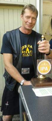 Jez serves our IPA at the Coach and Horses